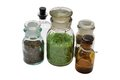 Flasks isolated a set of chemical bottles with different content on white Stock Image