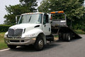 Flat bed tow truck empty white Royalty Free Stock Images