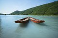 Flat boats anchored two lie at anchore on the river donau in austria Stock Photo