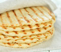 Flat bread on a white table Stock Images