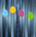 Flat easter eggs on blue wooden texture background bright vector holiday greeting card design Royalty Free Stock Photos