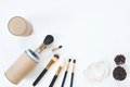 Flat lay of brushes with pearl bracelet on white background Royalty Free Stock Photo