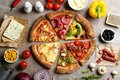 Flat lay composition with slices of delicious pizzas on grey marble table Royalty Free Stock Photo