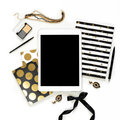 Flat lay fashion feminine home office workspace with tablet, stylish black gold notebooks, cosmetics and jewelry on white backgrou