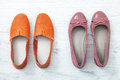 Flat lay fashion set: colored slippers shoes on white wooden background. Top view. Royalty Free Stock Photo