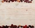 Flat lay frame of autumn crimson leaves, hazelnuts and walnuts o