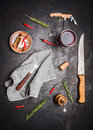 Flat lay with kitchen cooking tools glass of red wine herbs and spices on dark rustic background top view Royalty Free Stock Photo