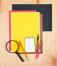 Flat lay office tools and supplies. Stationery on wood background. Flat design of workspace, workplace. Top view of desk backgroun Royalty Free Stock Photo