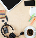 Flat lay office tools and supplies, tablet computer,cards, coffee and other stuff. Flat design and top view on desk as frame with Royalty Free Stock Photo