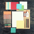 Flat lay office tools and supplies. Top view of desk background. Stationery on wood. Flat design of creative office workspace, wor Royalty Free Stock Photo