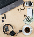 Flat lay of personal stuff, notebook computer,cards, coffee, money, camera photo and other. Flat design and top view on desk as fr Royalty Free Stock Photo