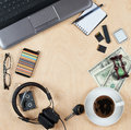 Flat lay of personal stuff, notebook computer,cards, coffee, money and other. Flat design and top view on desk as frame with blank Royalty Free Stock Photo