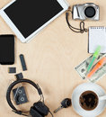 Flat lay of personal stuff, tablet computer,cards, coffee, money, camera photo and other. Flat design and top view on desk as fram Royalty Free Stock Photo