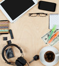 Flat lay of personal stuff, tablet computer,cards, coffee, money and other. Flat design and top view on desk as frame with blank c Royalty Free Stock Photo