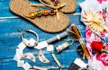 Flat lay of summer fashion with camera slippers sunglasses and other girl accessories on blue background Royalty Free Stock Photo
