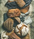 Flat-lay of various bread loaves on grey background, top view Royalty Free Stock Photo