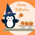 Flat penguin character stylized as witch with knife and with carved pumpkins. Halloween card template. Royalty Free Stock Photo