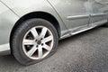 Flat rear tire on car Royalty Free Stock Photo
