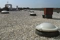 Flat roof with gravel and sky light windoows Royalty Free Stock Image