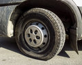 Flat tire on a truck parked on asphalt in direct sunlight Royalty Free Stock Images