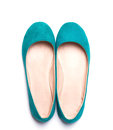 Flat woman shoes of bright turquoise color Royalty Free Stock Photo