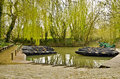 Flatboat jetty in the green venice of marais poitevin and canoe maillezais vendee department pays de la loire france water Royalty Free Stock Photo