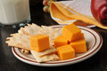 Flatbread crackers and cheese gourmet with aged cheddar an apple milk Royalty Free Stock Images