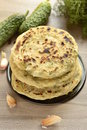Flatbread with greens selective focus vertical Royalty Free Stock Images