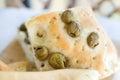 Flatbread italy focaccia olives closeup flat oven baked italian bread genovese ligure Royalty Free Stock Image