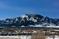 Flatirons Mountains in Boulder, Colorado on a Cold Snowy Winter Royalty Free Stock Photo