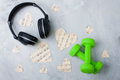 Flatlay sport music composition headphones paper hearts dumbbell Royalty Free Stock Photo
