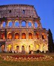 Flavian amphitheatre or coliseum in rome italy april the at twilight on april the is an iconic symbol of and one of the most Stock Image