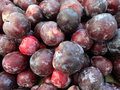 Flavor king pluot prunus flavor king interspecific plum apricot hybrid with reddish purple skin and crimson flesh sweet with spicy Royalty Free Stock Photos
