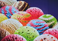 Flavored ice cream scoops colored Royalty Free Stock Image