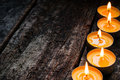 Flavored spa candle on a wooden background Royalty Free Stock Photography