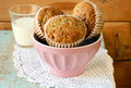 Flax lemon poppy seed muffins in a bowl and glass of milk Stock Images