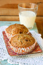 Flax lemon poppy seed muffins and glass of milk Stock Photography