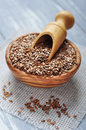 Flax seeds in wooden bowl on wooden background Stock Photos