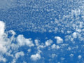 Fleecy clouds blue sky Royalty Free Stock Image