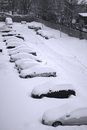 Fleet of cars parked covered with snow Royalty Free Stock Image