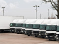 Fleet lorries company of commercial parked in a row ready for cargo distribution Royalty Free Stock Images