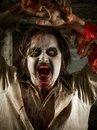 Flesh eating zombie photo of a hungry covered with blood about to attack you Royalty Free Stock Photography