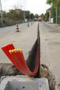 Flexible conduits on the road building site for optical fibre Stock Photo