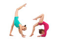 Flexible kids gymnasts doing acrobatic feat, isolated on white background Royalty Free Stock Photo