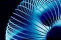 Blue Flexible Slinky Spring Royalty Free Stock Photo