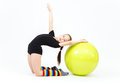 Flexible teen girl doing gymnastics exercises on fitness ball Royalty Free Stock Photo