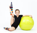Flexible teen girl doing gymnastics exercises on fitness ball Royalty Free Stock Photo