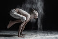Flexible yoga man doing hand balance asana brahmachariasana.