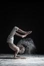 Flexible yoga man doing hand balance asana vrischikasana. Royalty Free Stock Photo