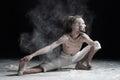 Flexible yoga man doung wide side lunge or utthita namaskarasana.